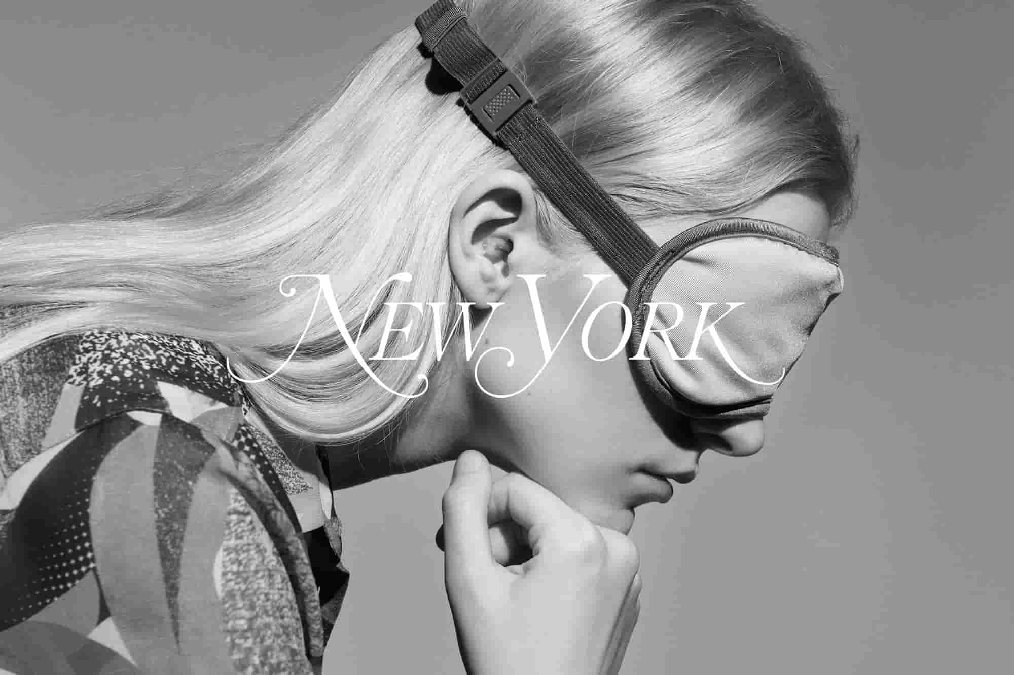 Woman with a sleeping mask and earplugs in ears posing for New York Magazine